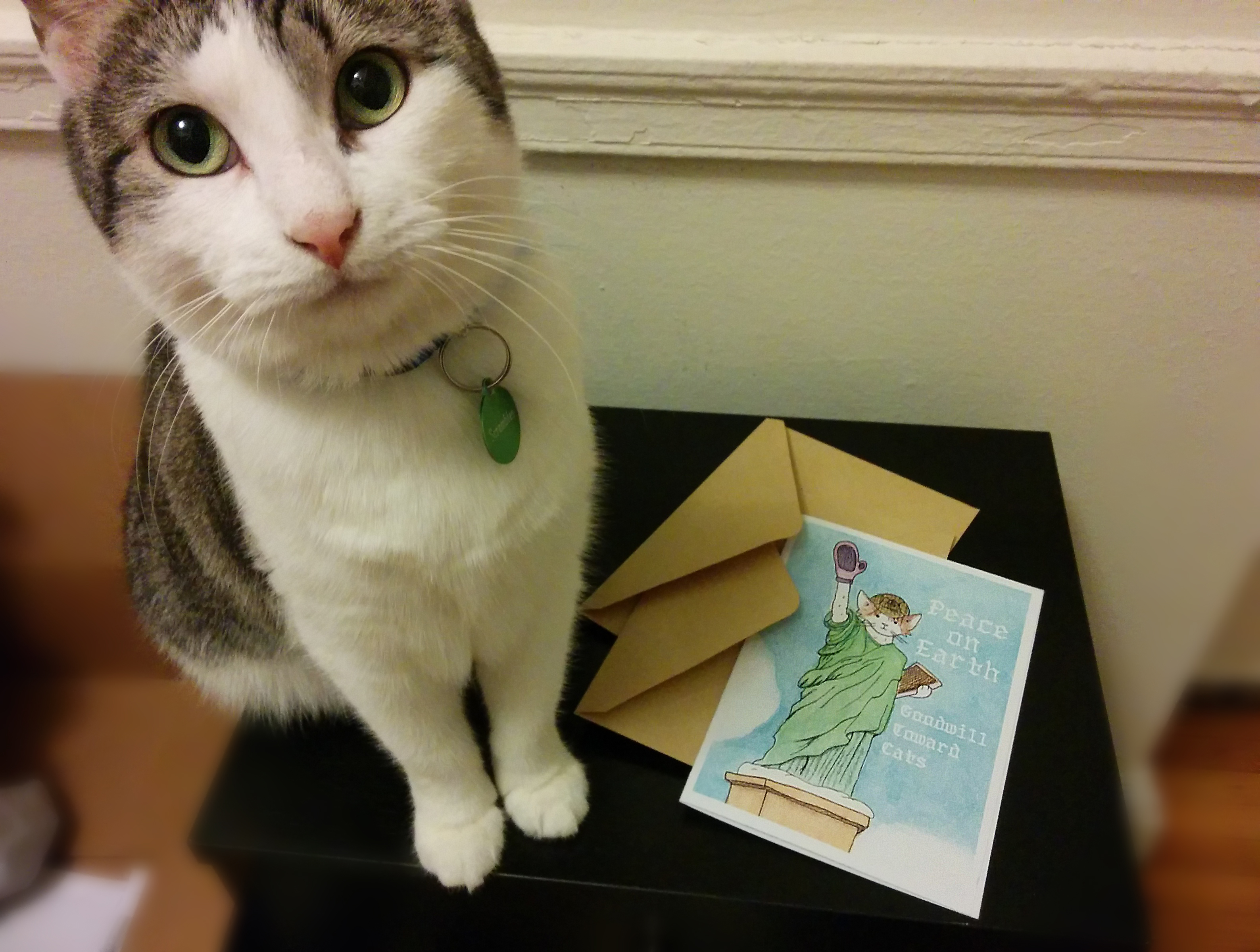 Inspector Scrambles poses with a card of her as the Statue of Liberty